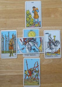 MOON/KNIGHT OF SWORDS, 5 WANDS, 9 WANDS, 7 PENTACLES, KNIGHT CUPS.