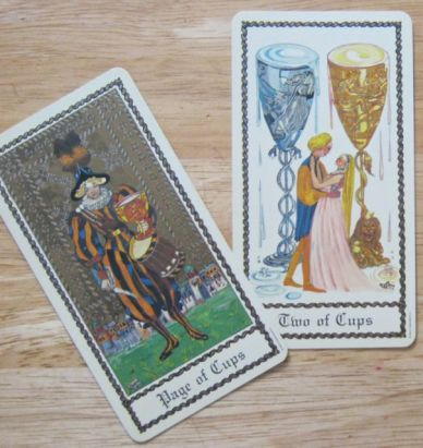 Image 2: two of cups crossed by page of cups